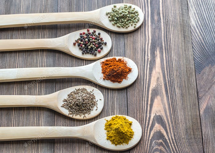 Assortment of spices on the wooden spoons