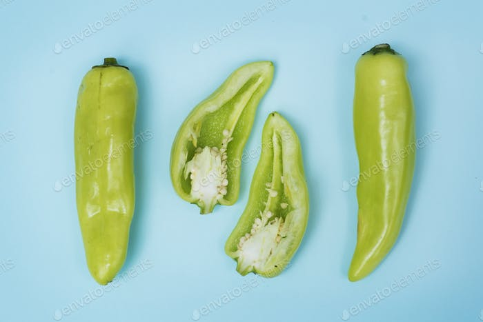 Thumbnail for Aerial view of fresh jalapeno peppers on blue background