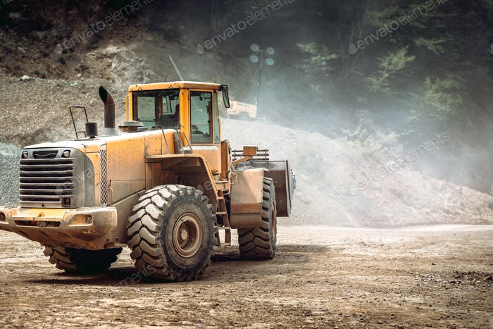 heavy duty industrial wheel loader loading rock and  ore