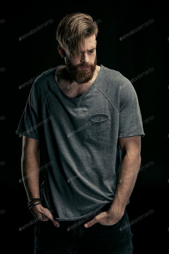 portrait of stylish man in shirt on black