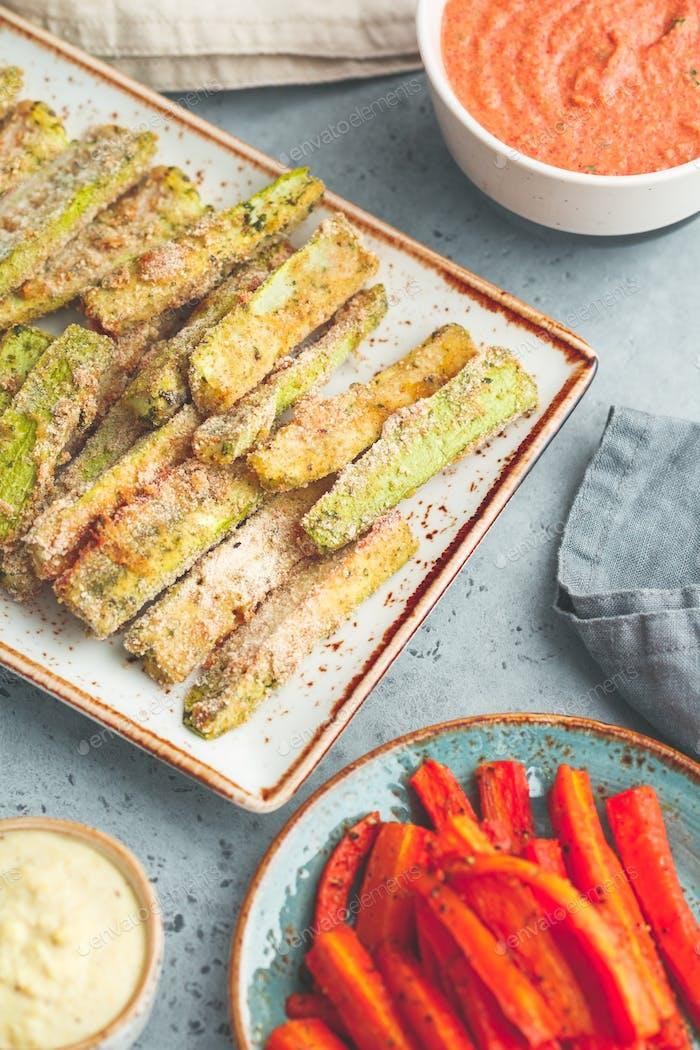 Set of baked season vegetable sticks with sauce and hummus. Vegetarian healthy food.