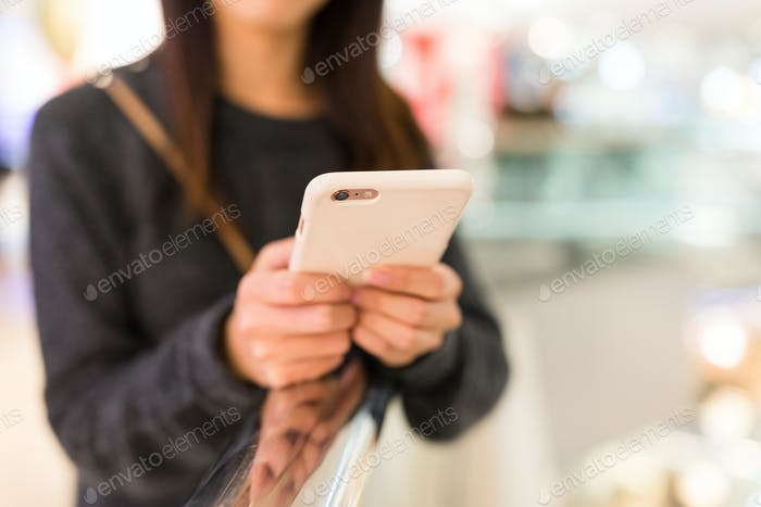 Woman using mobile phone for online