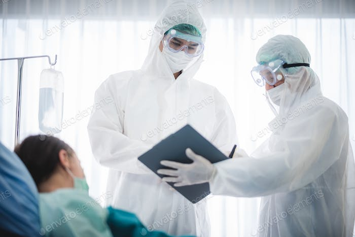 The doctor examines the patient's history in hospital or clinic