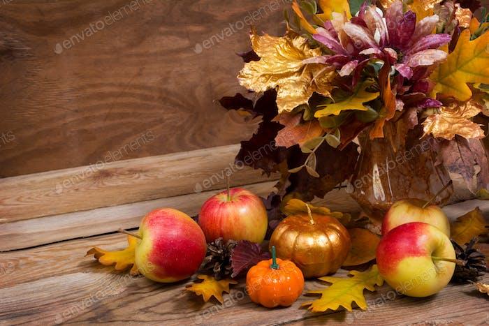 Fall centerpiece with purple flowers, golden pumpkin