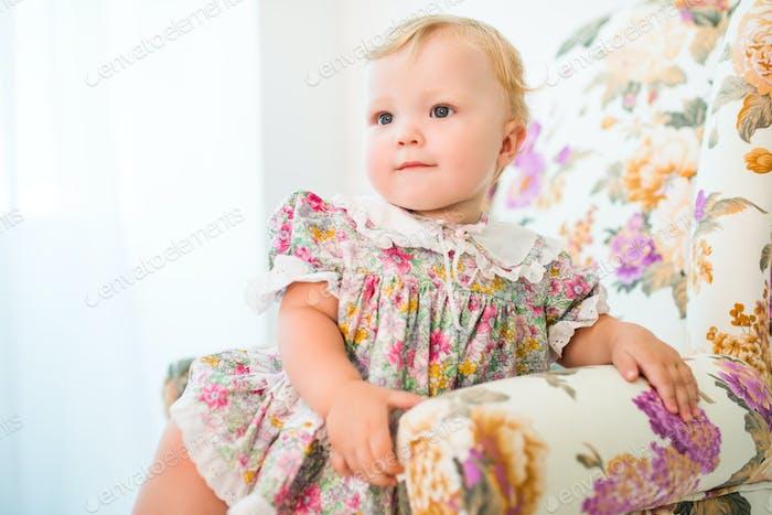 Portrait of a cheerful pretty fair-haired girl