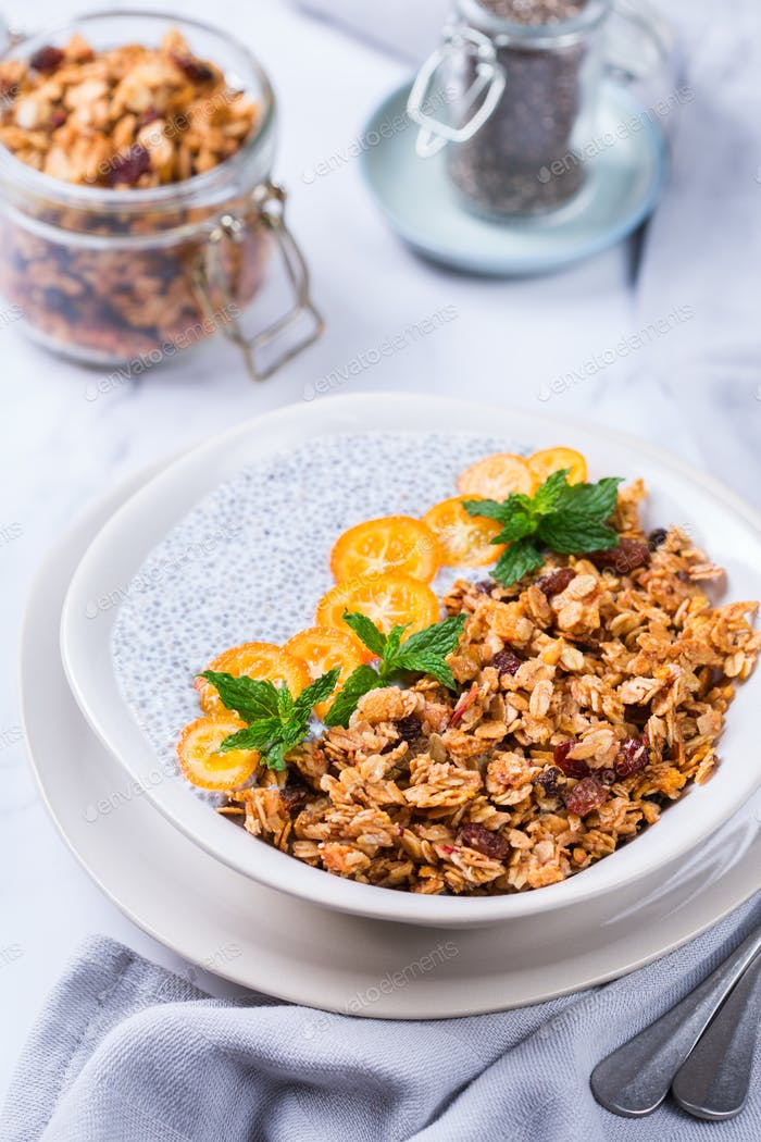 Chia pudding bowl with homemade granola and kumquats for breakfast
