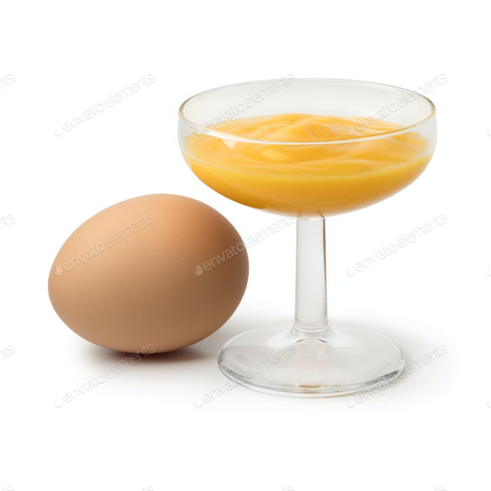 Glass with traditional dutch egg liqueur and an egg