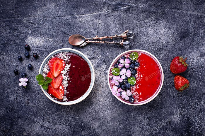 Smoothie bowls with strawberry and blueberry