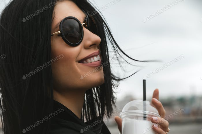 Thumbnail for brunette girl keeping takeaway drink