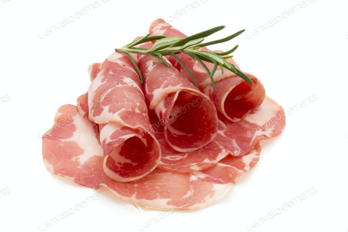 Dried pig meat slices. Delicatess.