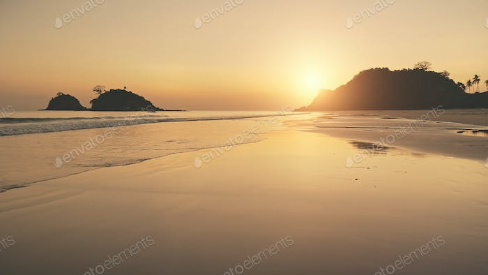 Silhouette of paradise mountains islands at sunset. Aerial sun set light reflect at nobody seascape