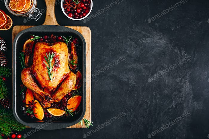 Christmas roasted chicken or turkey with spices, oranges and cranberries