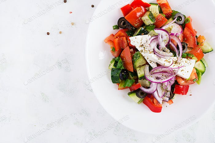 Trendy salad. Greek salad  with fresh vegetables, feta cheese and black olives