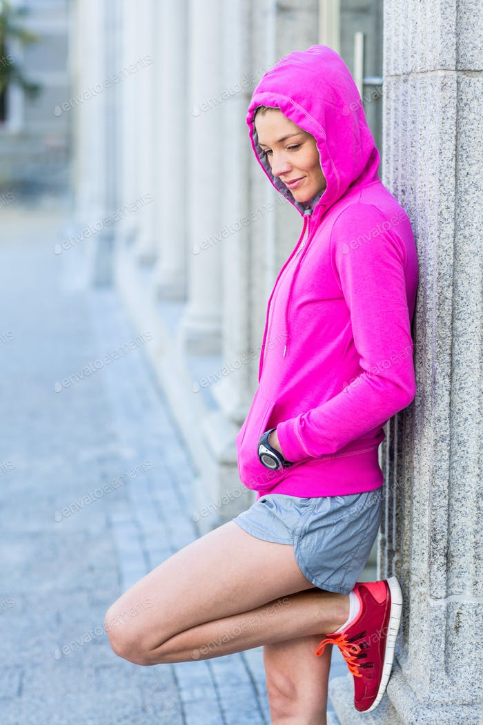A woman wearing a pink jacket on a sunny day