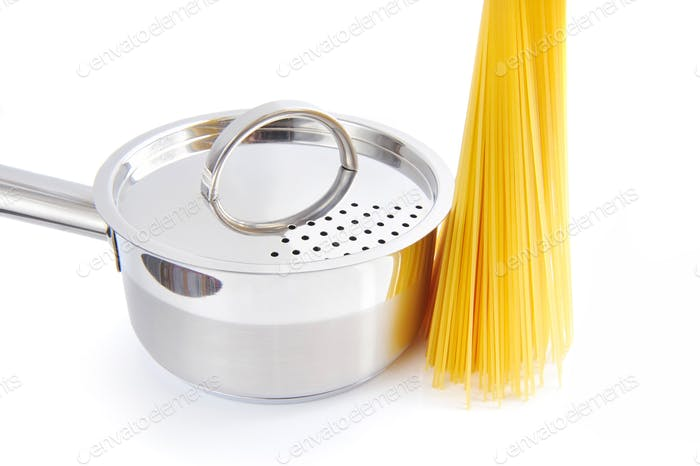 Bunch of spaghetti and pan on a white background