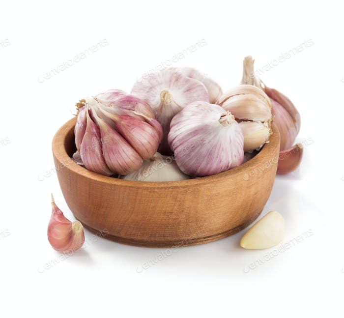 garlic in bowl isolated on white