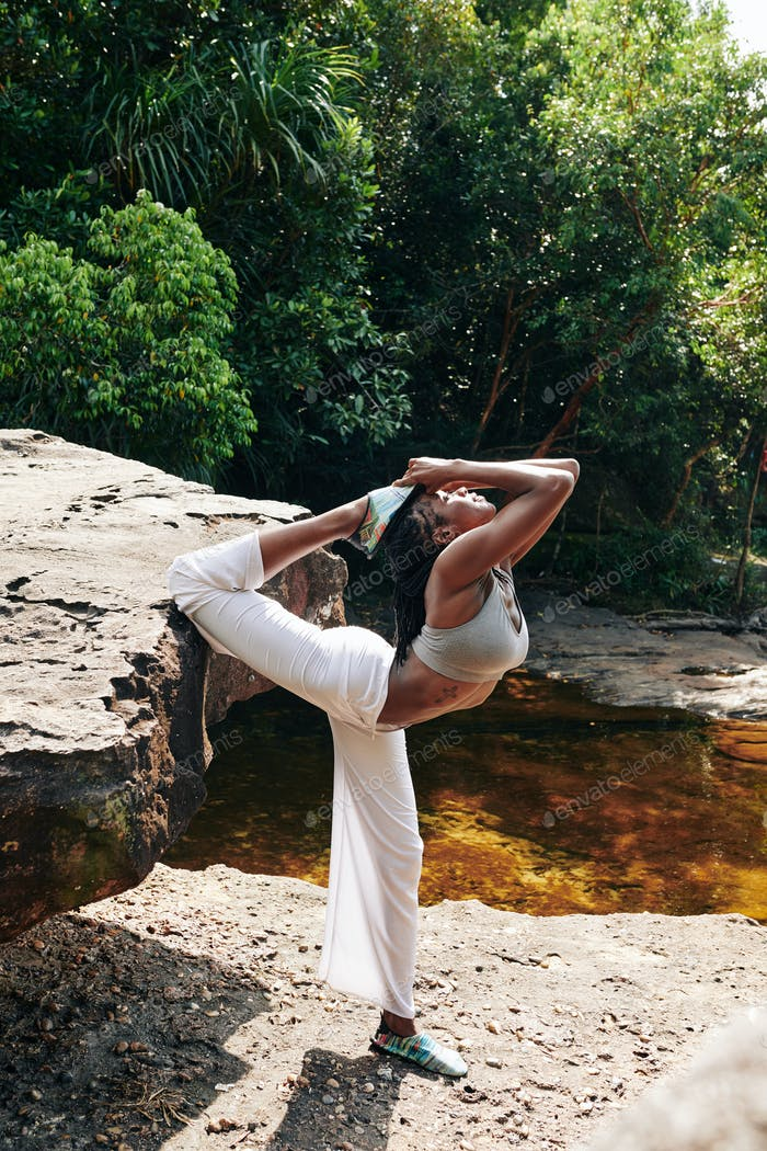 Woman doing advanced yoga backbends