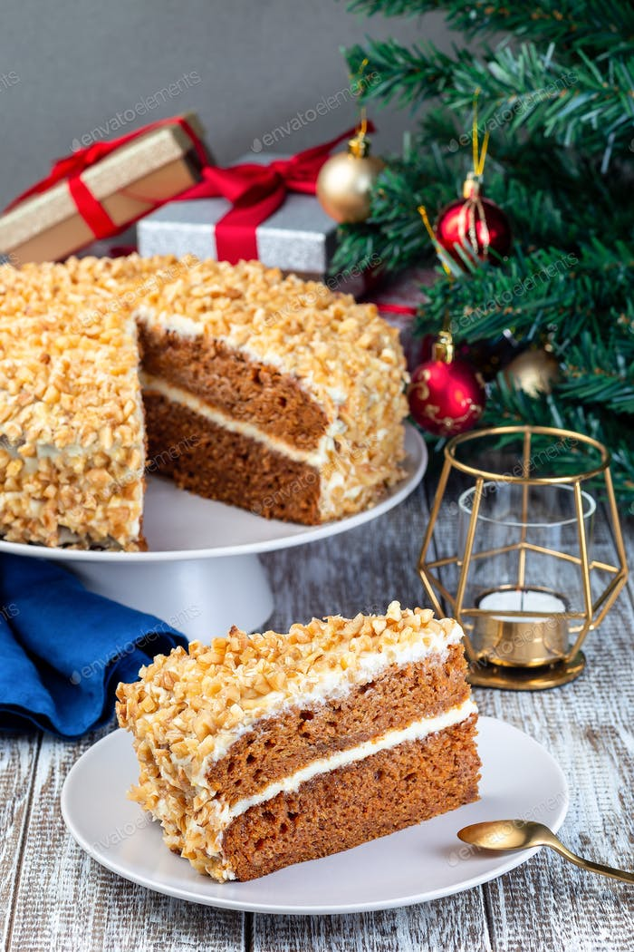 Piece of Carrot cake with cream cheese frosting and walnuts