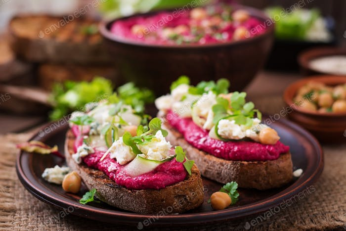 Vegan sandwiches with beetroot hummus, cucumber and blue cheese