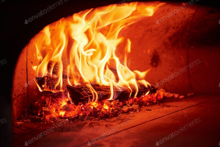 Fire burning in the furnace. Close up view of wood in flames