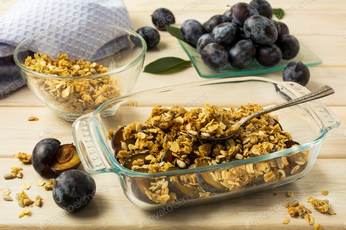 Breakfast fresh plum granola in the glass baking tray