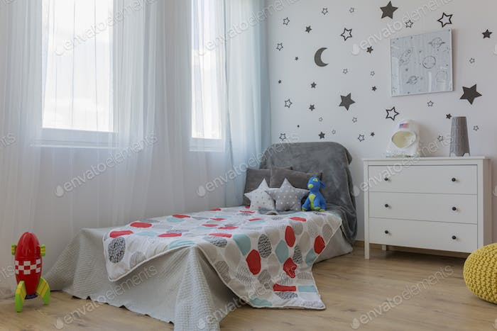 Bed in space themed bedroom