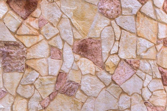 Hintergrund aus roter Steinmauer