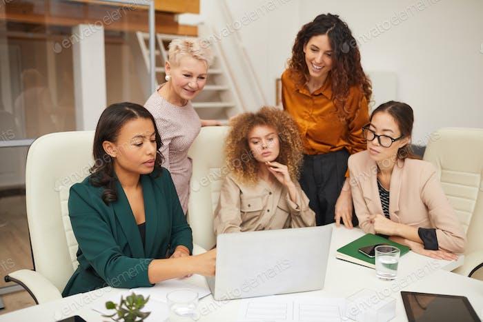 Five Businesswomen Coworking In Office