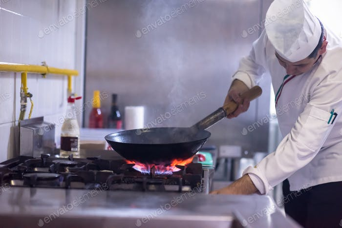 chef preparing food, frying in wok pan