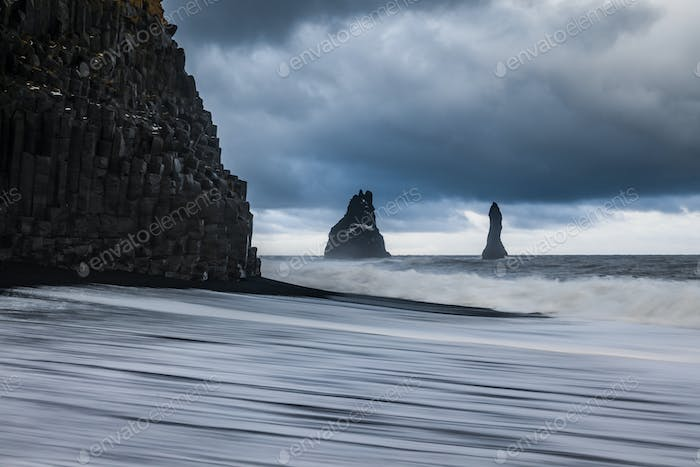 Basalt rocks Troll toes on black beach at storm. Reynisdrangar, Vik, Iceland