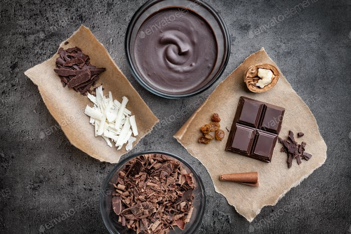Delicious chocolate on rustic background