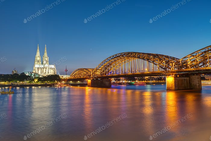The famous Cologne Cathedral and the Hohenzollern railway bridge