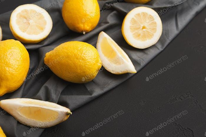 Variety of ripe citruses on black background