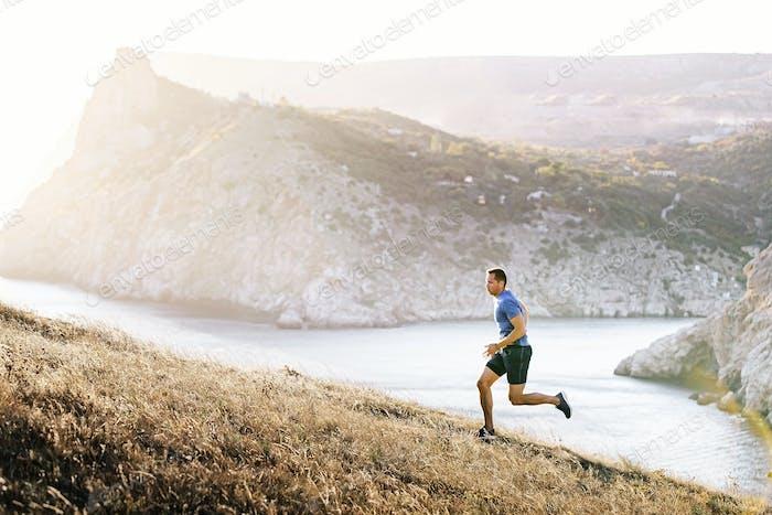athlete running uphill