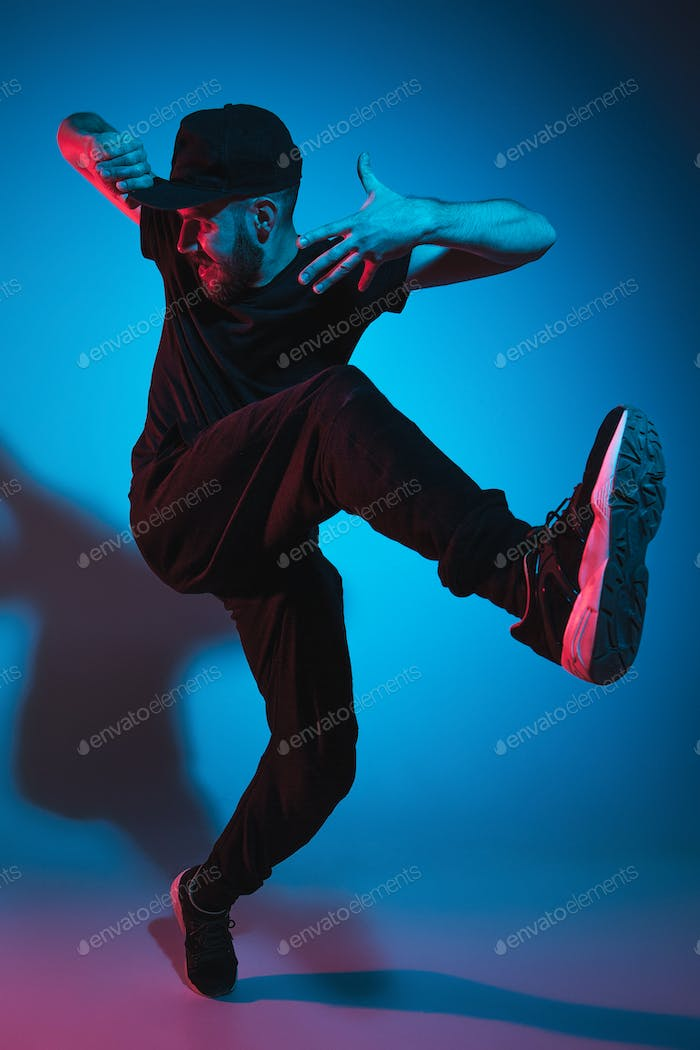 69a1ff4df58 The silhouette of one hip hop male break dancer dancing on colorful  background