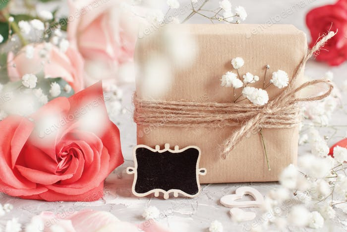 Gift bags, small chalkboard and flowers