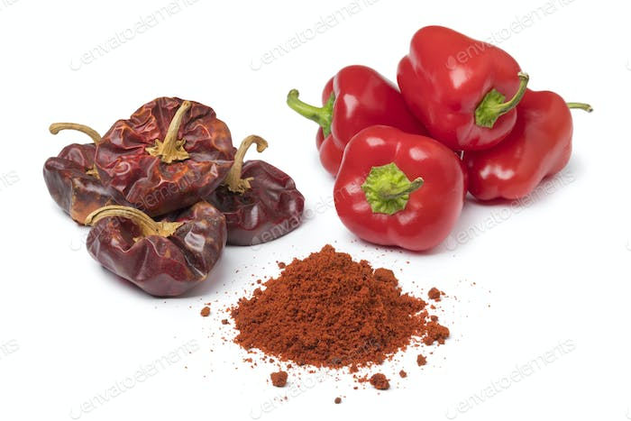 Dried and fresh red bell peppers and a heap of powder