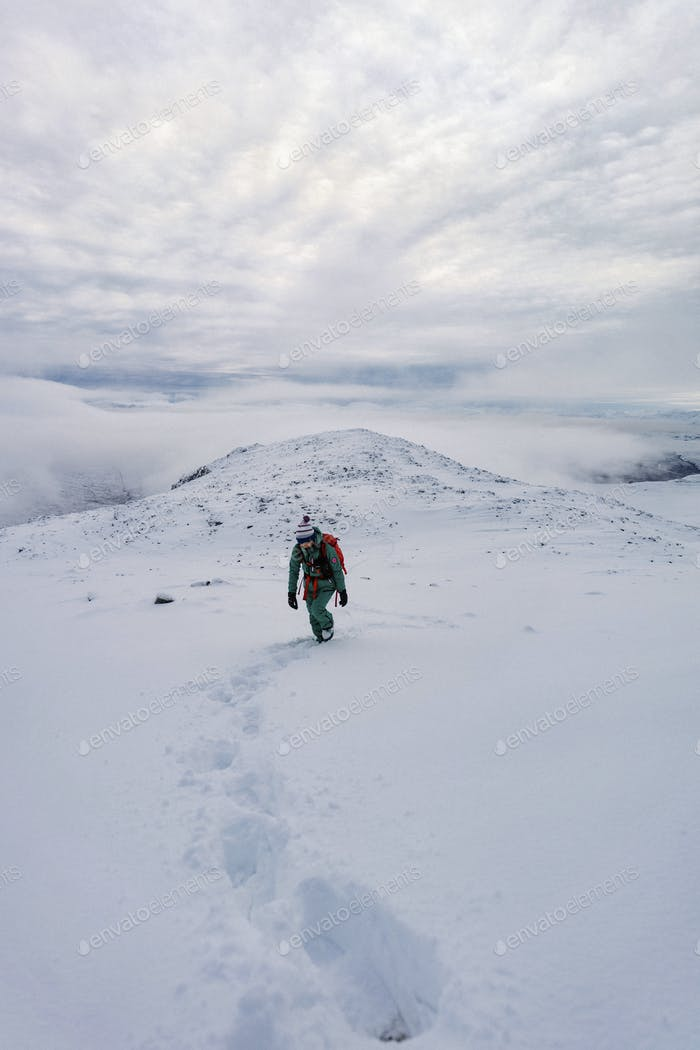 Trekking on a snowy mountain
