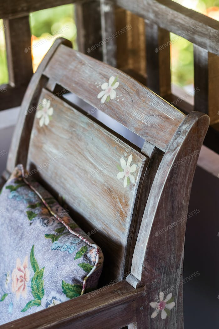 Wooden vintage furniture with handmade colorful pillows
