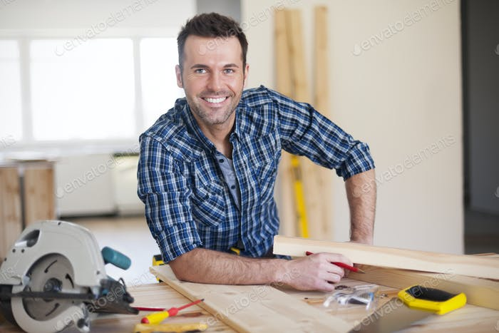 Smiling construction worker at work