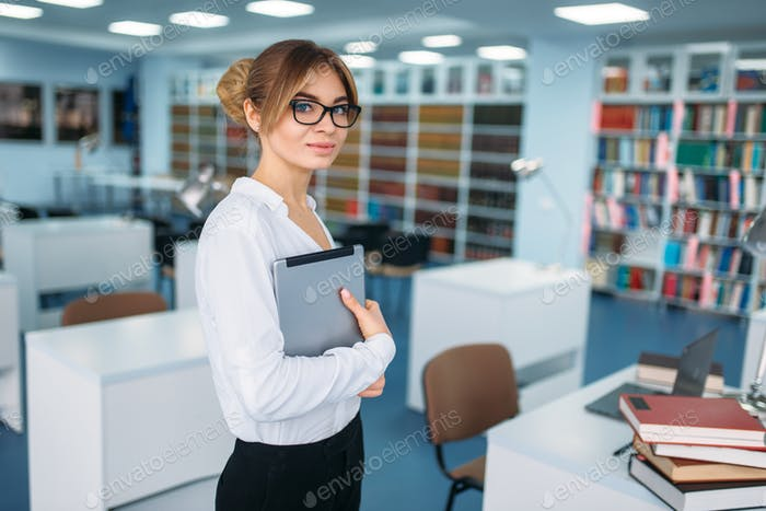 Female person standing in university library