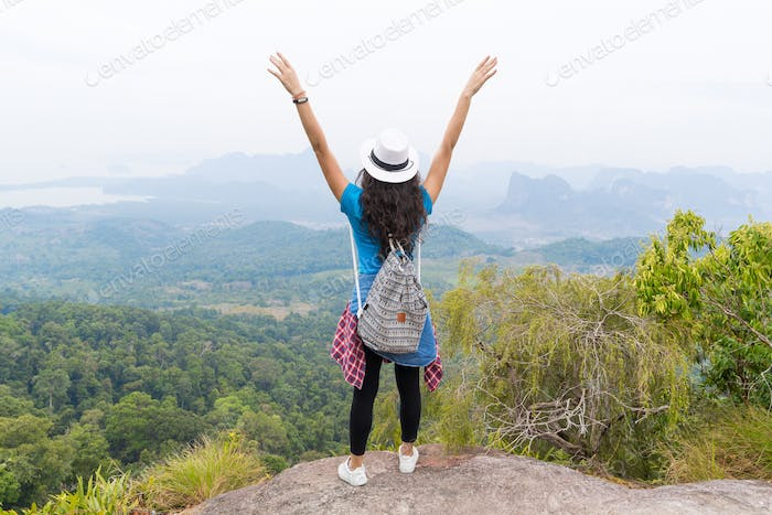 Tourist Girl With Backpack Standing On Mountain Top Raised Hands Back Rear View Enjoy Beautiful