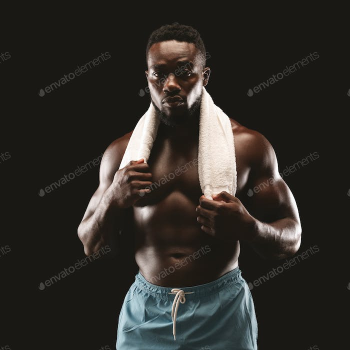 Portrait of young african athletic guy after gym