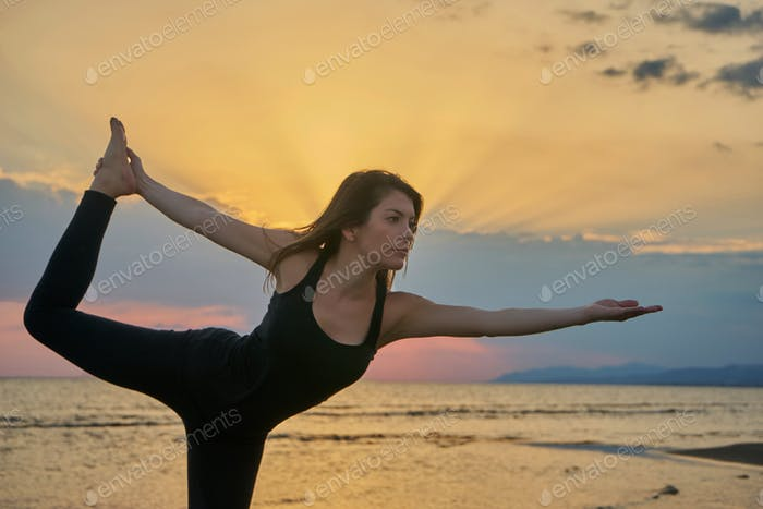 Woman practicing yoga in various poses (asana)
