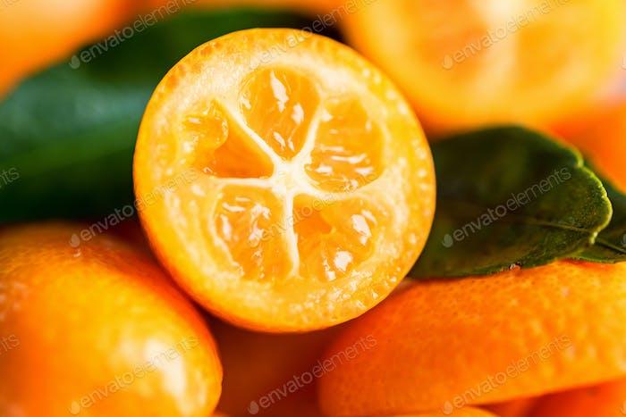 Kumquat or cumquat on wooden table