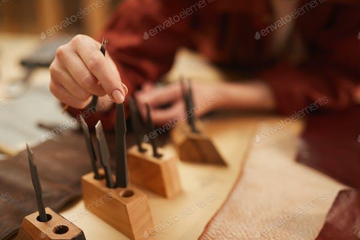 Unrecognizable Artisan Choosing Tools