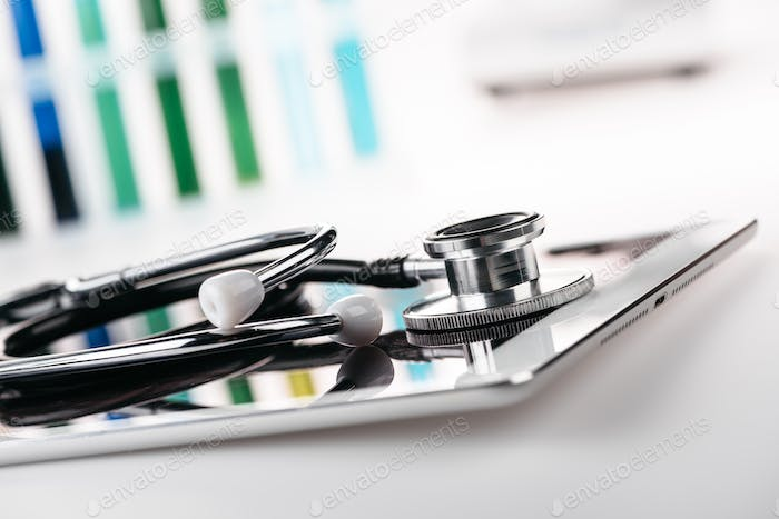close up view of stethoscope on digital tablet on white