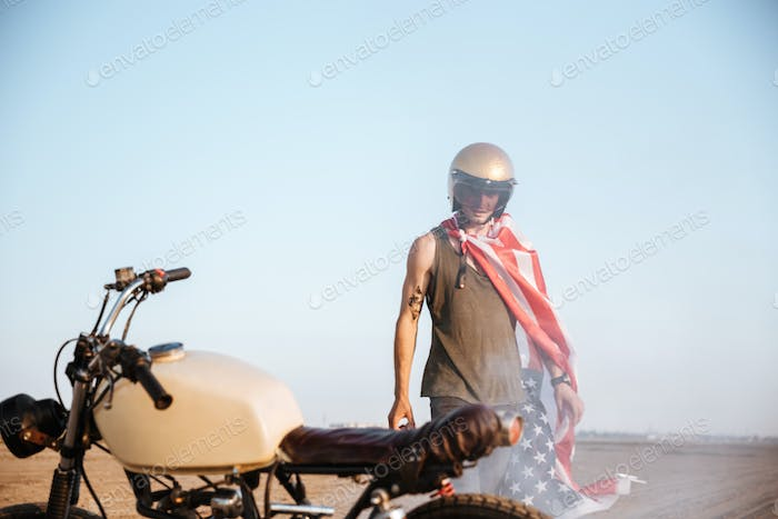 Close up of motorcycle with a man on the backgroud