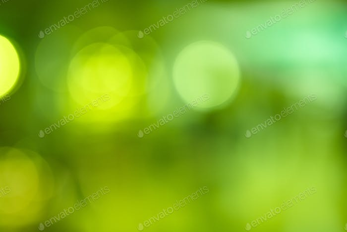 Green lights out of focus abstract background. Copy space. Horizontal