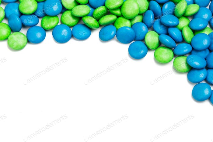Top rame of blue green chocolate candy on white background
